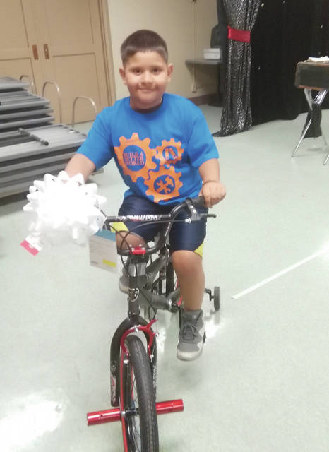 The Delta Public Library held their summer reading club Award's Day at Memorial Hall on July 6. Justin Cruz was the grand prize winner of a brand new bicycle. The bicycle was purchased by the Friends of the library.