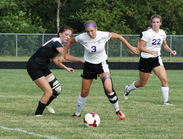 Swanton's Kirsten Truckor (3) works the ball around Jocelyn Masters of Van Buren Friday in the girls soccer season opener. She would score the winning goal with five seconds remaining to give the Bulldogs a 3-2 victory.