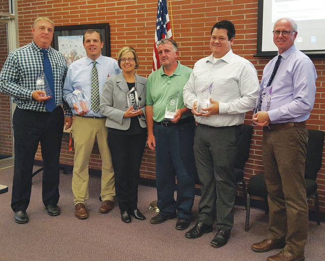 The Swanton Board of Education honored several individuals for their work on the building project. They are, from left, Steve Smith, Jason Longbrake, Joyce Kinsman, Glen Dominique, Brandon Schroth, and Kevin Young. Matt Smith and Christian Martinez were also honored but not in attendance.