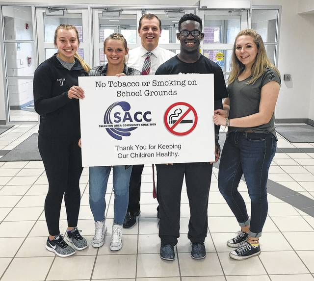 On Sept. 14, SEED (Students Encouraging Educated Decisions) students, from left, Sidney Taylor, Ally Hendricks, Xavier Williams, and Abigail Scicere, presented a new tobacco free and no smoking on school grounds sign to the principal Jason Longbrake at Swanton High School.