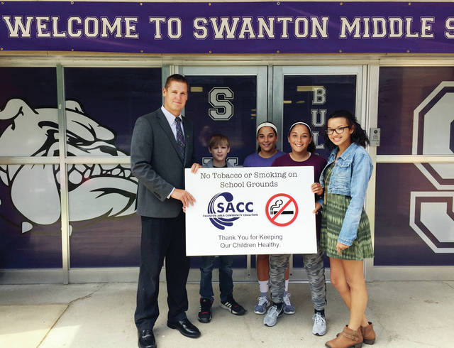 On Wednesday, SEED (Students Encouraging Educated Decisions) students, Camren Stewart, Aricka Lutz, Averie Lutz, and Jasmin Kenzie, presented a new tobacco free and no smoking on school grounds sign to the Principal Matt Smith at Swanton Middle School. Throughout the year, students learn about the dangers of drugs, and chose as their project to make changes to the current tobacco sign. These students advocated during the previous school year for an updated tobacco free sign, to make it more specific in wording, and make the size and colors more visible to students and visitors. SACC congratulated all SEED students for their efforts throughout the year, and also, thanked Swanton Middle School administration for listening to the students' concerns.