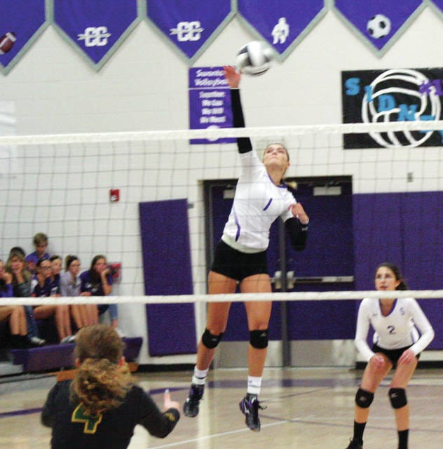 Julia Smith of Swanton does work at the net in a game against Evergreen earlier this season. With 20 kills, she helped lift the Bulldogs to a 23-25, 25-12, 25-17, 25-22 win over Bryan Tuesday night.