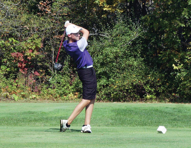 Carter Swank of Swanton watches his tee shot at the third hole Friday during the NWOAL Golf Championships at Auglaize Golf Course in Defiance. He shot an 84 for the Bulldogs and finished in a tie for 13th with Jay Vann of Delta.