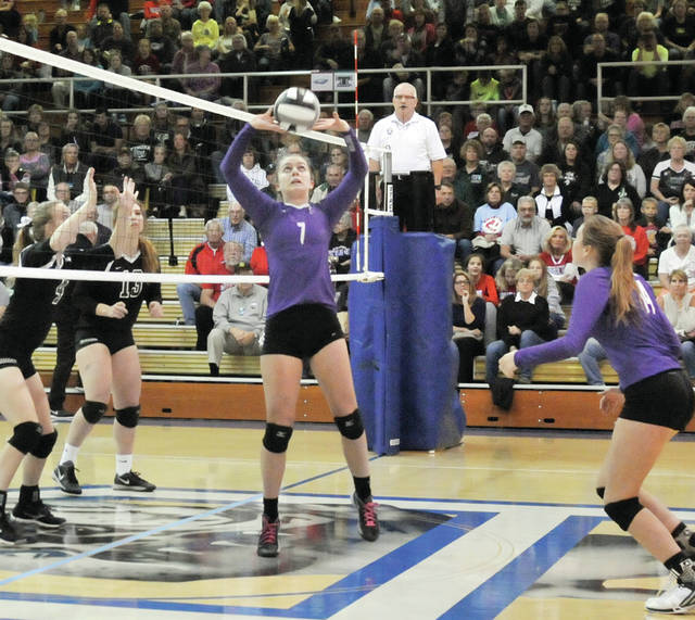 Abby Arnold of Swanton sets one up for her team Wednesday during the Division III volleyball district semifinal at Defiance High School. The Bulldogs fell to the Rams in four sets, ending their season.