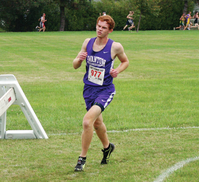 Brett Bettinger of Swanton in the boys race at the NWOAL Cross Country Championships Saturday at Homecoming Park in Wauseon. He took 12th with a time of 18:06.47.