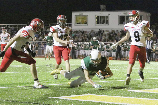 Josh Dowling of Evergreen dives into the end zone for one of his two touchdowns in the Vikings' 42-14 home loss against Wauseon Friday night.