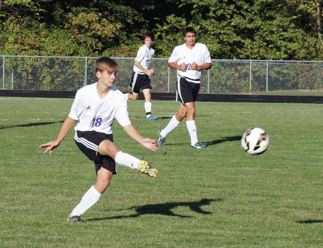 Wyatt Lake of Swanton sends a ball upfield Thursday versus Whitmer. The Bulldogs fell to the Panthers 7-0.