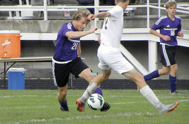 Swanton's Chase Moore handles the ball Monday against Maumee in the Division II boys soccer sectional semifinal. The Bulldogs came up short against the Panthers, 8-1.