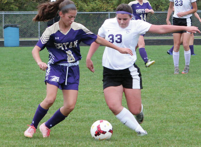Swanton's Tonya Timpe, right, and Maci Tinkel of Bryan fight for possession of the ball on Thursday.