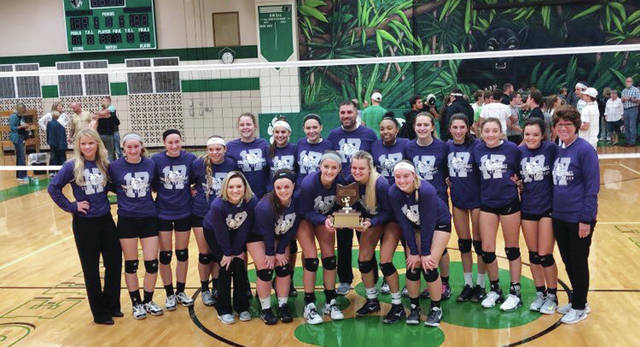 The Swanton volleyball team poses with the NWOAL trophy after defeating Delta last Tuesday to win the league title outright. They open the sectional tournament at home versus Northwood tonight at 6:30 p.m.