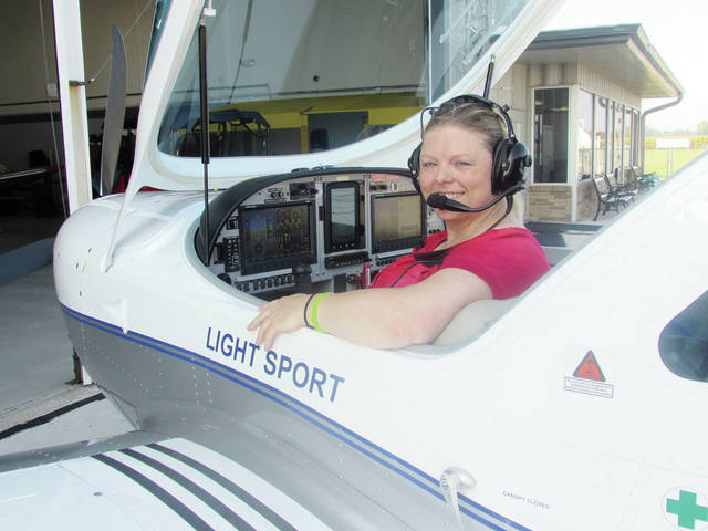 Rachel Naves sits at the controls of the Sport Cruiser model plane available for training at Fulton County Airport.