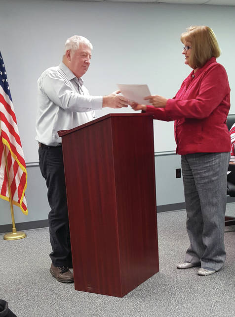 Swanton Mayor Ann Roth reads a proclamation in support of Small Business Saturday with board member Bill O'Connell representing the Swanton Chamber of Commerce.