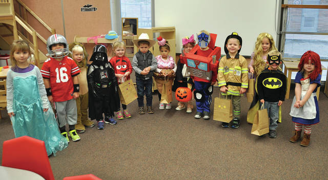 Children from the Four County Career Center Preschool/Childcare Center went trick-or-treating through the school for Halloween recently gathering candy and goodies from the staff at the Career Center. Shown above, the trick-or-treaters include, from left, Jayden Elmer (Helena); Stryker Oyer (Napoleon); Zachary Norden (Napoleon); Brennan Vandock (Delta); Audrey Brywczynski (Whitehouse); Zane Reed (Napoleon); Giuliana Zetter (Toledo); Elowyn Custer (Wauseon); Malcolm Custer (Wauseon); Jordan Inkrott (Delta); Sylvie Zartman (Antwerp); Micah Helberg (Napoleon); and Isabella Schoonover (Defiance). The Preschool/Childcare Center is open Mondays through Fridays from 8 a.m. - 4 p.m., except on days the Career Center is closed.