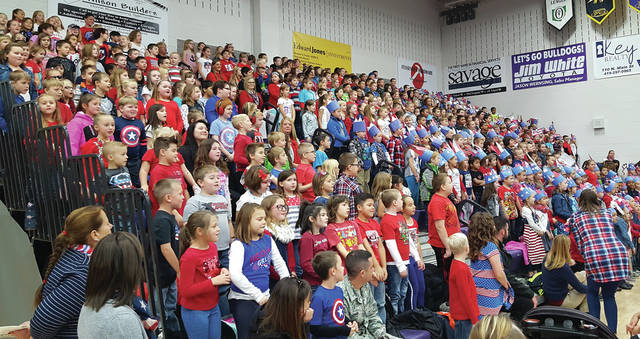 "Swanton Elementary School students sing ""Thankful for the USA"" during the Veterans Day Program at Swanton High School on Friday."