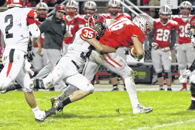 Wauseon's Joey Shema (35) brings down Carter Brooks of Shelby Friday night in an opening round playoff game. The Indians fell to the Whippets 50-13, ending their season.