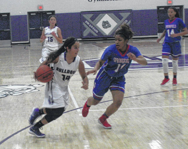 Aricka Lutz of Swanton drives in from the wing Thursday against Springfield in a non-league game. The Bulldogs would fall to the Blue Devils 45-33.