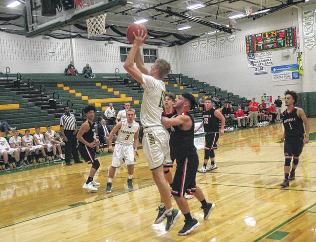 Chandler Lumbrezer of Evergreen with a basket in the paint Thursday versus Fostoria in the opening round of the Northwest Ohio Holiday Classic. The Vikings defeated the Redmen 61-41.