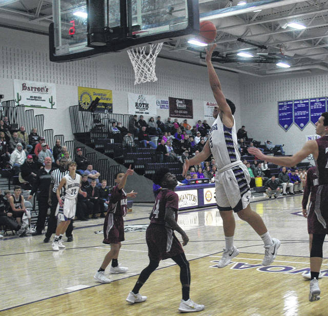 Hunter Mix of Swanton scores during a non-league game against Rossford Wednesday. Swanton defeated the visiting Bulldogs 46-33.