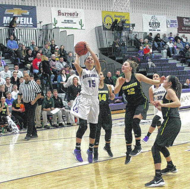 Haley Nelson of Swanton puts one in the hoop Friday versus Evergreen. However, the Bulldogs came up short to the Vikings 51-49.