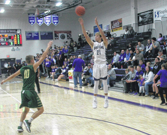 Randy Slink of Swanton buries a three-pointer in the first half Friday versus Evergreen. He finished with nine points for the Bulldogs in their 40-39 victory.