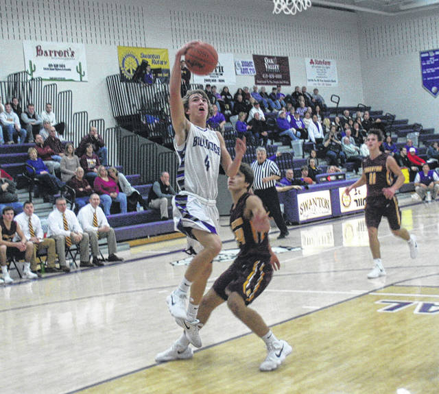 Josh Vance lays one in for Swanton Tuesday versus Edgerton. Swanton would fall to the visiting Bulldogs by a 42-28 final.