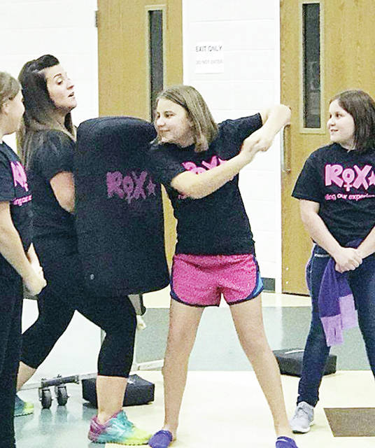ROX coordinator Jaime Fogerty instructs Delta Middle School fifth grader Natalie Friess in self-defense. The ROX program was created to empower girls and help them traverse life's challenges.
