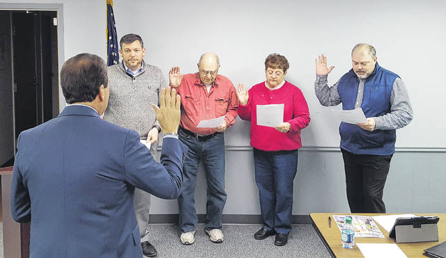Swanton Council members elected in November, from left, Michael Rochelle, Paul Dzyak, Kathy Kreuz, and Craig Rose, take the oath of office as adminsitered by village solicitor Alan Lehenbauer.