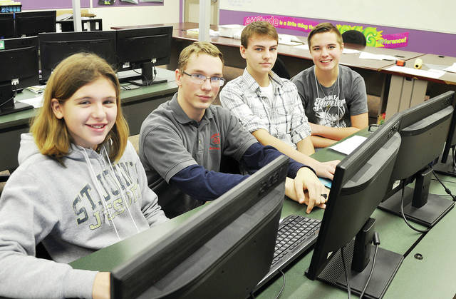 """Evergreen Middle School eighth graders recently participated in """"Exploring Careers Hands On for 8th Graders"""" (ECHO) held at Four County Career Center in Archbold. Career Explorers from FCCC guided the students through several careers that were of interest to them as they look forward to planning for their future. Shown with Evergreen eighth graders, from left, Callie Benner, Kaden Sanford, and Logan Nidek is Career Explorer from Evergreen in the Computer Design/3D Modeling lab, second from left, Andrew Louy. ECHO for 8th Graders is made available to all eighth graders in the four county area."""