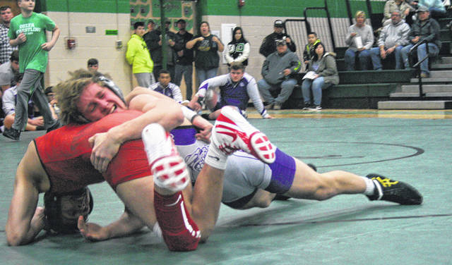 Chase Moore of Swanton, right, imposes his will during the 152-pound match against Mauricio Barajas of Wauseon Thursday in a NWOAL quad at Delta. Despite Moore earning a 2-1 win, the Bulldogs fell to the Indians 56-15 which was their first league loss of the season.