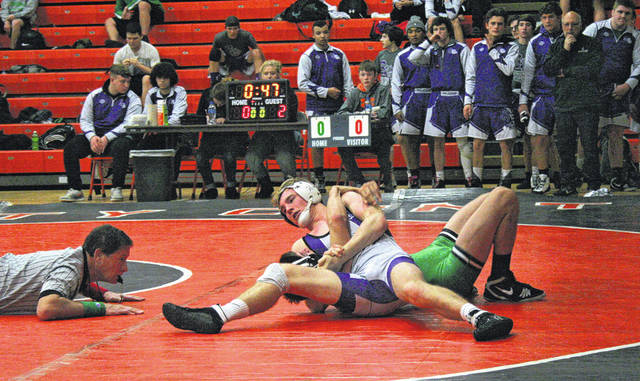 Gage Pachlhofer of Swanton works over Dawson Swicegood of Delta Thursday during an NWOAL quad at Liberty Center. He would pin Swicegood as the Bulldogs defeated the Panthers 54-27.