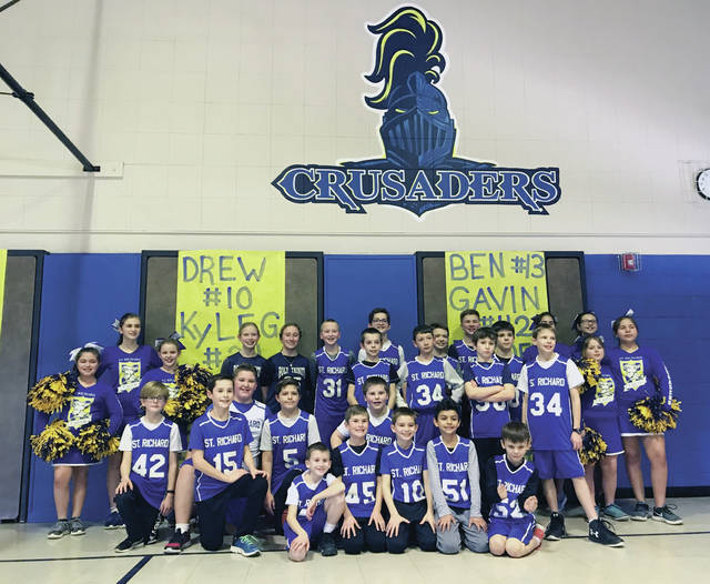 St. Richard School Crusaders enjoy their new mural during their winter sports pep rally.
