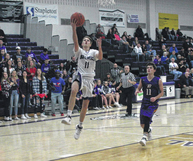 Jared Wilson of Swanton lays one in Friday against Bryan in Northwest Ohio Athletic League play. The Bulldogs fell to the Golden Bears 43-41.