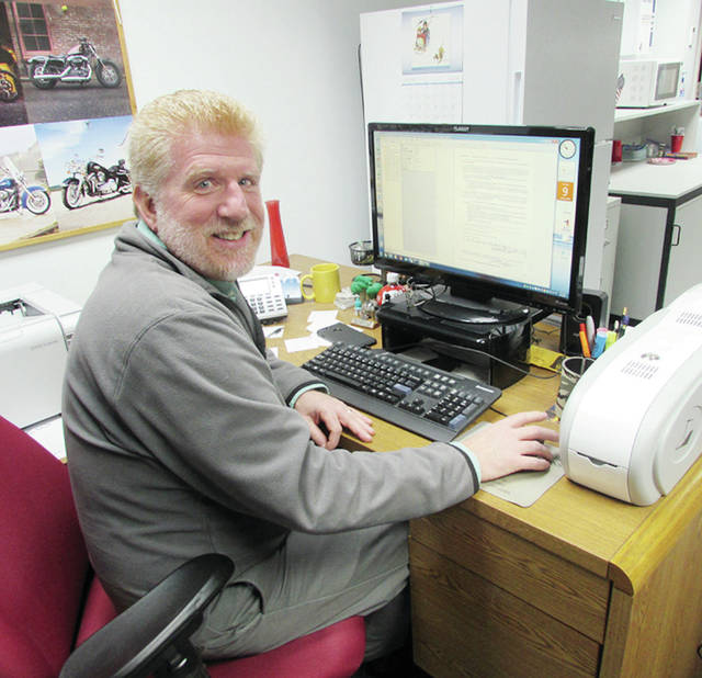 Ken Bidwell works each day to transfer Fulton County's voluminous permanent records onto computer servers.