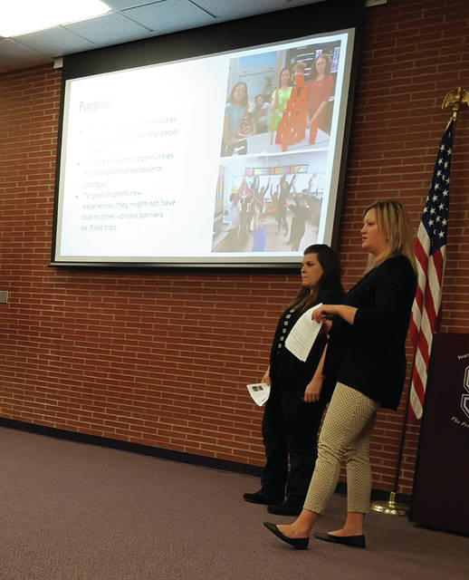 Julie LaPoint and Amanda Carrizales tell the Swanton Board of Eduaction about the ALPHA program.