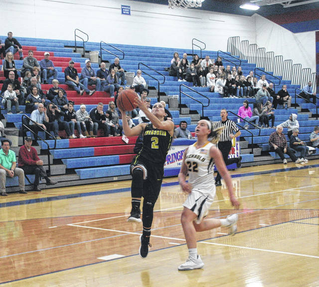 Evergreen's Hannah Herr converts a fast break opportunity against Archbold last Tuesday.