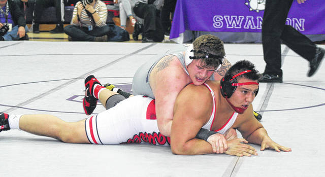 Tommy Lytle of Swanton, top, takes on Alex Sosa of Wauseon for the league championship at 285 pounds. He defeated Sosa 3-1 by an ultimate tie breaker to earn the Bulldogs' only individual title.