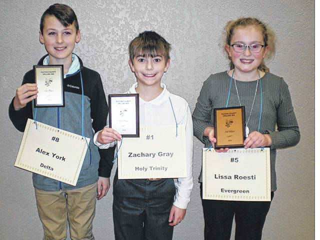 Fourth Grade Spelling Bee placers, from left, Alex York, Zachary Gray, and Lissa Roesti.