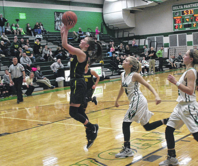 Bailie Sutter of Evergreen with a basket in the second half of an NWOAL game at Delta Thursday. The Vikings fell to the Panthers 47-42.