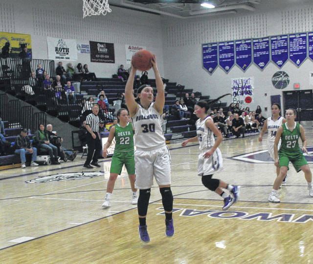 Swanton's Sidney Taylor grabs a rebound in a NWOAL game against Delta this season. She made first team all-league for the Bulldogs.