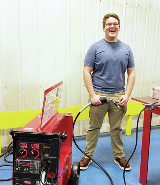 Day one of a new welding course at Swanton High School was about teaching safety and the PPE (personal protective equipment) needed for welding. Pictured is Dakota Spence getting a feel for a new welding machine.