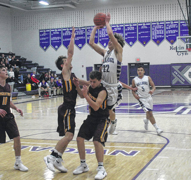 Dylan Gilsdorf of Swanton draws a foul in a game this season. The junior was recently selected honorable mention District 7.