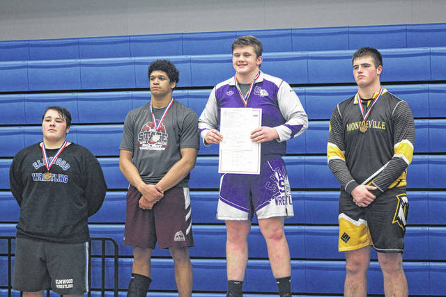 Swanton's Tommy Lytle stands atop the podium after winning the 285-pound title at the Division III district meet Saturday at Defiance.