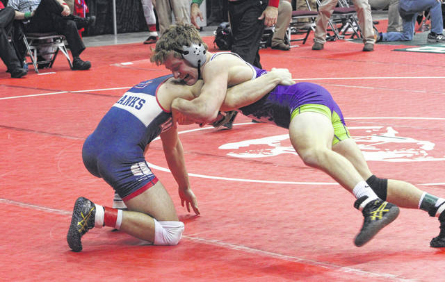 In a rematch of the district final a week earlier, Swanton's Chase Moore, right, defeated Trevor Franks of Lakota in the consolation bracket Friday during the Division III State Wrestling Tournament. Moore would place fourth at 152 pounds for the Bulldogs.