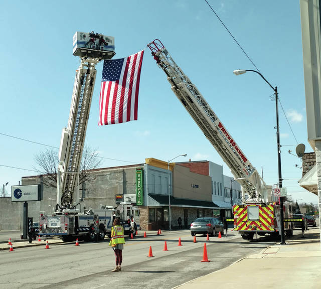 Former Swanton firefighter/paramedic Patricia Brown was honored by firefighters from around the area last Tuesday. An arch was formed by ladder trucks from Whitehouse and Wauseon in Delta for Brown's funeral procession.