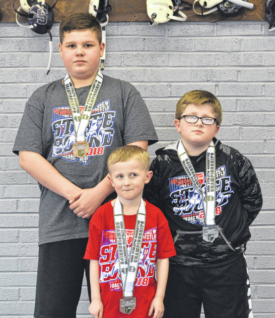 Pictured, from left: Evan Smigelski, Dalton Cook, Dominic Cook.