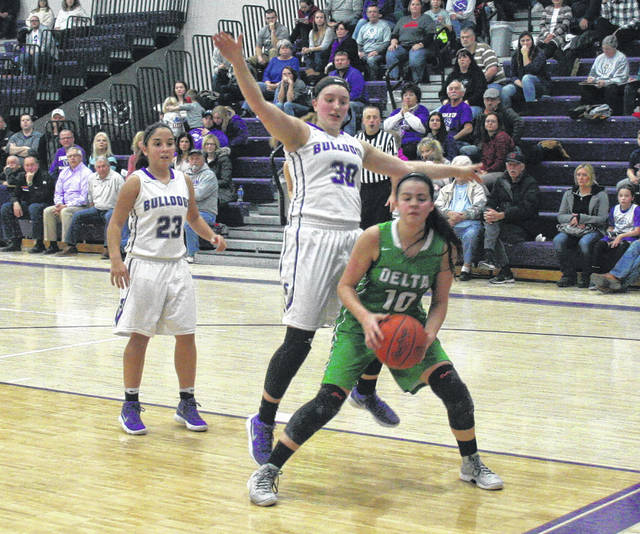 Sidney Taylor of Swanton (30) defends Brooklyn Green of Delta in a league game this season. Taylor made honorable mention all-district in Division III.