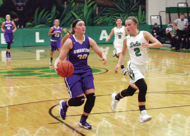 Swanton's Sidney Taylor advances the ball upcourt in a game against Delta this season. Taylor was recently named second team District 7.