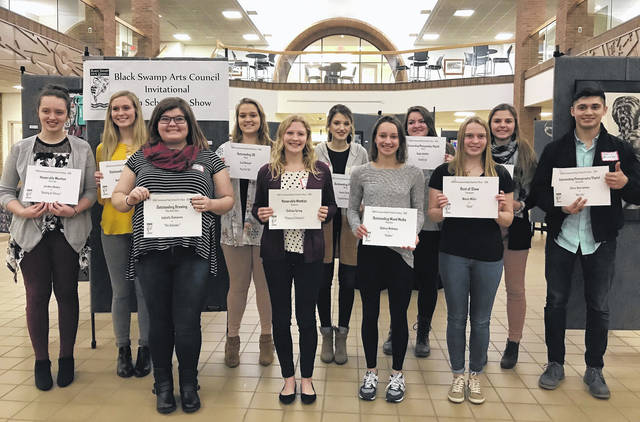 Winners of the 2018 Black Swamp Arts Council High School Invitational Art Show were honored at the awards show Feb. 22, at Northwest State Community College. Winners were, from left, Front Row: Isabella Summers – Pike-Delta-York (Outstanding Drawing); Callista Spring – Napoleon (Honorable Mention); Sydney Neikamp – Napoleon (Honorable Mention); Nicole Miller – Evergreen (Best of Show); Chris Barrientos – Ayersville (Best Photgraphy/Digital). Back row: Jordan Skates – Pettisville (Honorable Mention); McKenna Grube – Bryan (Outstanding Drawing); Lexi Dietsch – Bryan (Oustanding 3D); Avery Carter – Bryan (Outstanding Painting); Kayla Altaffer – Bryan (Outstanding Photography/Digital); Aubrey Wyse – Hilltop (Outstanding Printmaking). Honorable Mention Winners not pictured were: Madison Baugh – Wauseon; Cody Moser – Stryker; and Brittney Willis – Bryan.