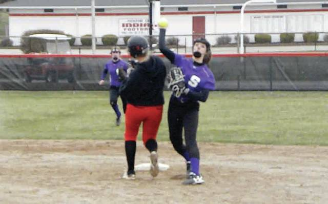 Kailey Brownfield of Swanton, right, throws to first base for an out as Wauseon's Macee Schang heads toward second. The Bulldogs fell to the Indians 12-0 Monday, but they responded the next day with a 17-7 home win over Lake.