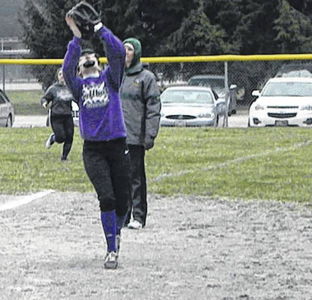 Swanton's Jessica Dohm prepares to catch a foul pop-up against Evergreen in NWOAL softball Wednesday. The Bulldogs fell to the Vikings 21-11.